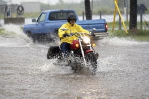 rain cycle  300x199 - Practice To Ride Safely In The Rain, Says NY And PA Motorcycle Law Lawyer
