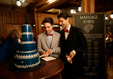 LGBT couple, Alex+Sergio, cutting their wedding cake