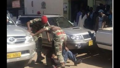 Photo of Braaing soldiers brutally assault cop for enforcing lockdown