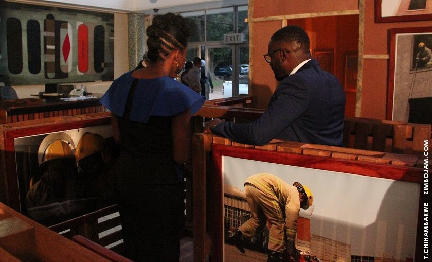 Chikosi and Washe admiring showing some of their pics. PIC: T. CHIHAMBAKWE | ZIMBOJAM.COM