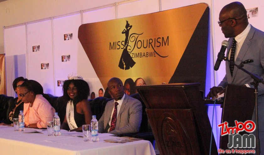 Minister of Tourism, Mr E. Mbwembwe reading his speech at the MTZ press briefing.