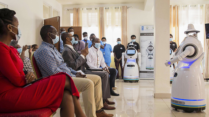A COVID-19: Rwanda In Free Testing, Robot Caregivers