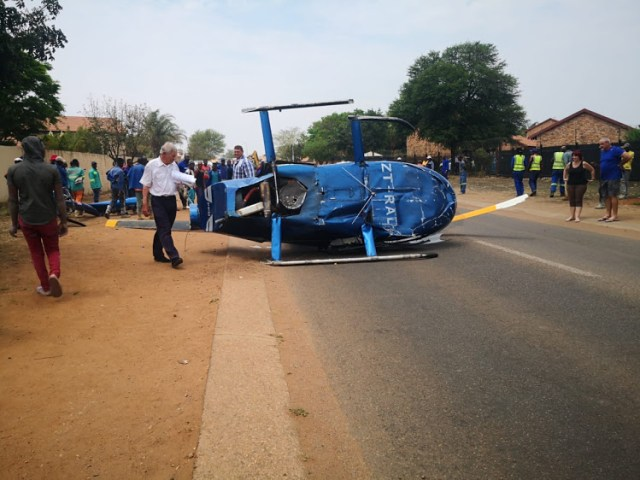 CHOPPER CRASHES ONTO A ROAD