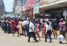 COVID-19 time bomb: Crowding continues in Harare's unending queues for everything