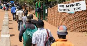 """""""Buy Tickets If You Want To Go Home, Buses Are Available"""": Stranded Zimbabweans in S.A told"""