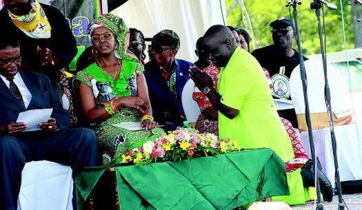 Martin Dinha bowing down before Grace Mugabe - FILE
