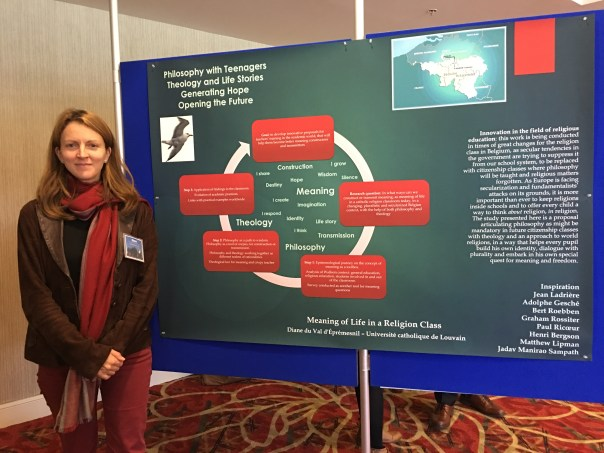 photo of Diane with her poster at the REA conference 2016