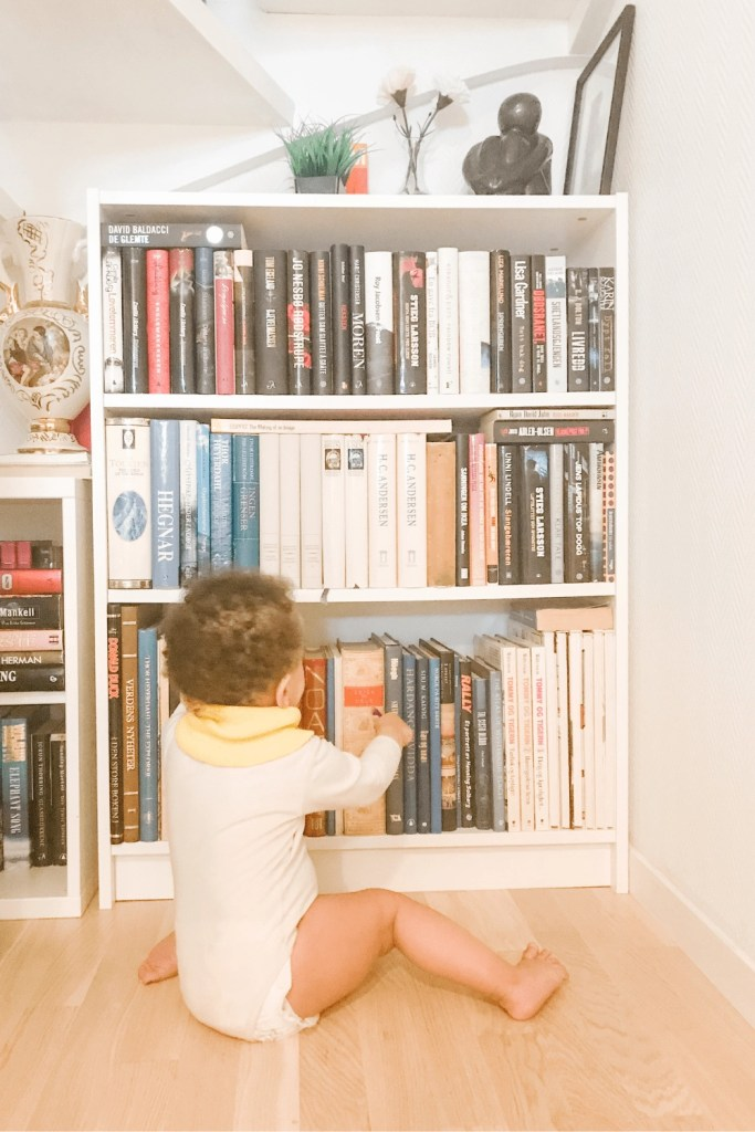 a baby touching books