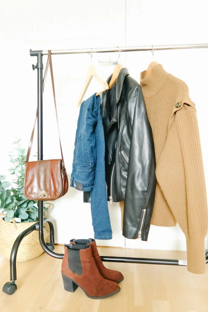 boots, leather jacket, bag, sweater and jeans