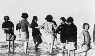 Greek and Armenian orphan refugees experience the sea for the first time, Marathon, Greece.
