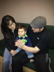Baby Leif (centre, pictured with parents Harumi Inokoshi and Eric Roe) is growing up bilingual, hearing Japanese from his mother and English from his father.  (Photo: Janet Werker, UBC Infant Studies Centre)