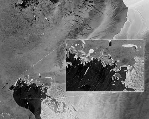 Icebergs that appear to have broken off Thwaites glacier spread across Pine Island Bay. PHOTOGRAPH BY NASA