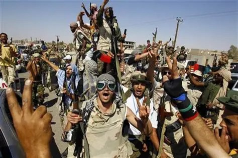 Libyan fighters chants slogans as they take control of Moammar Gadhafi loyalists' villages in the desert some 750 km south of Tripoli, at Gohta, north of the southern city of Sahba on Sunday. Credit: Francois Mori / AP