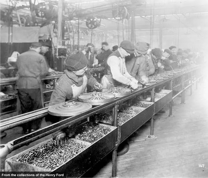 Ford's transition to moving assembly lines began in April 1913 with the integrated (and complex) flywheel/magneto. With each worker assigned to complete a few specific tasks rather than build the entire unit, Ford reduced magneto assembly time from about 15 minutes to 5, and the required workforce decreased from 29 to 14.