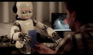 An iCub humanoid robot in IDSIA's robotics lab. Credit: Wikimedia Commons