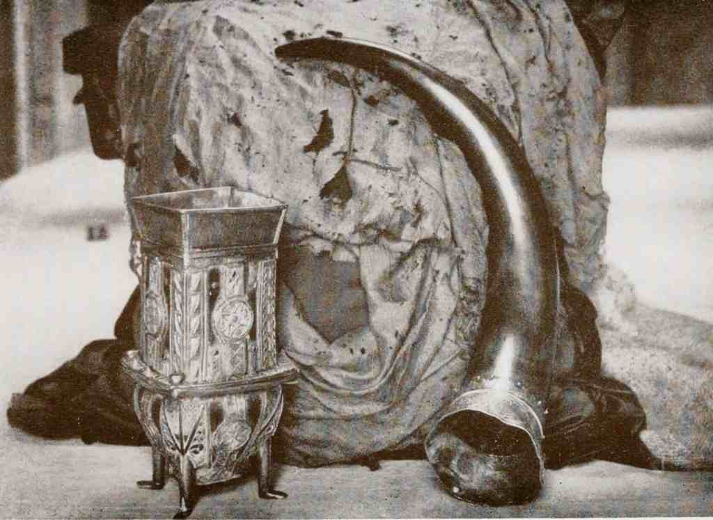 A photo of the Dunvegan Cup, Fairy Flag, and Rory Mor's Horn, all cherished heirlooms of the MacLeod clan. Photo by Roderick Charles MacLeod, 1927.