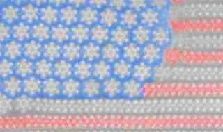 "This U.S. flag is only a couple nanometers wide or thousands of times thinner than a human hair. It's practically invisible to the human eye and the tiniest Old Flag ever. This pattern appeared unexpectedly when researchers heated the ""stripe"" material molybdenum ditelluride. Credit: University of Texas at Dalla."