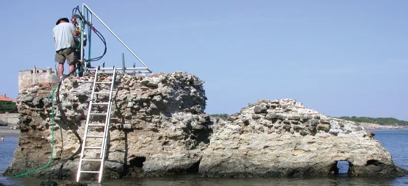 Samples from this Ancient Roman pier, Portus Cosanus in Orbetello, Italy, were studied with X-rays at Berkeley Lab. Credit: J.P. Oleson.