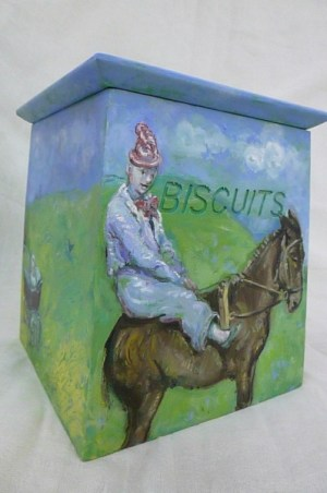 SHOPPING : The Circus Arrives - Painted Biscuit Box - Front Side of a painted wood biscuit box with a lid by artist Zoe Cameron of a circus clown dressed in costume sitting on a pony on green grass with blue sky