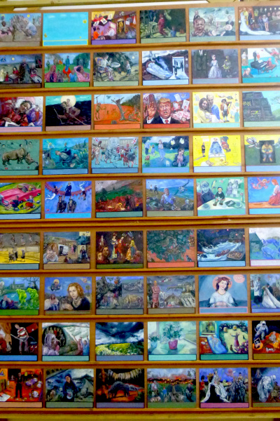 Detail : One Hundred Painted Vows. Rows of small oil paintings line the wall. In each the artist has recorded with an image and text a significant personal or world event .