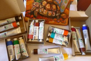 Old Holland oil paints just delivered , new on the table in boxes waiting to be used by the artist.