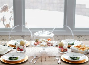 Zoe With Love shares her best tips for creating an easy Christmas tablescape that is easy on the budget but still beautiful and festive.