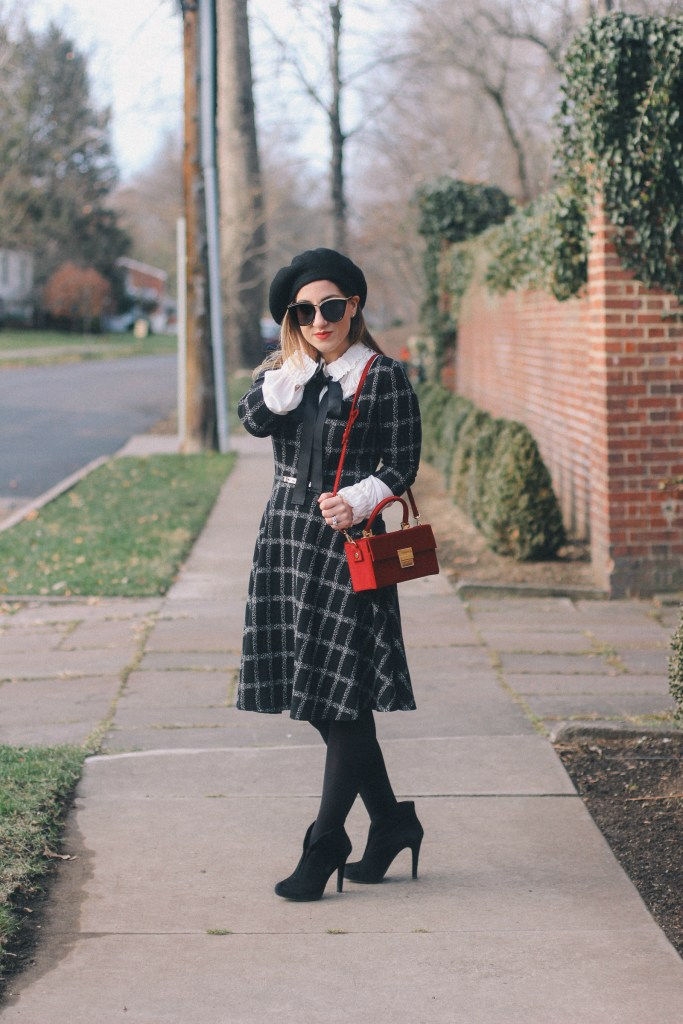 Pittsburgh Lifestyle Blogger Zoe With Love styles a windowpane dress by print mixing a leopard coat with a mini red bag, bow blouse and black accessories