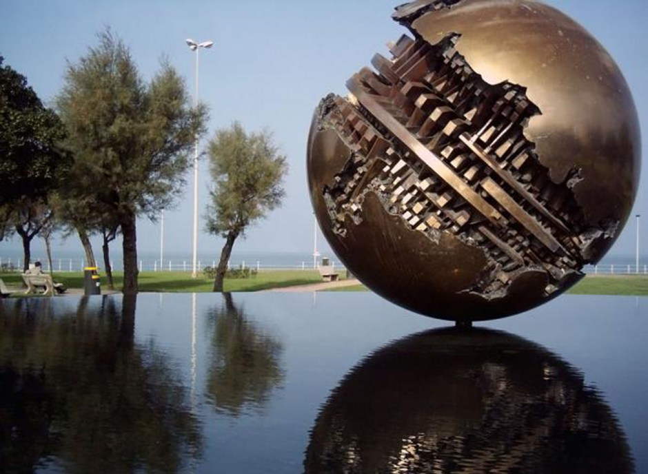 APRIL 2015   ARNALDO POMODORO The bronze sculpture on the seafront in Pesaro   © Twice25/WikiCommons Throughout his extraordinary career, Pomodoro has explored themes of time and human development -- from archaic writing to space ships.