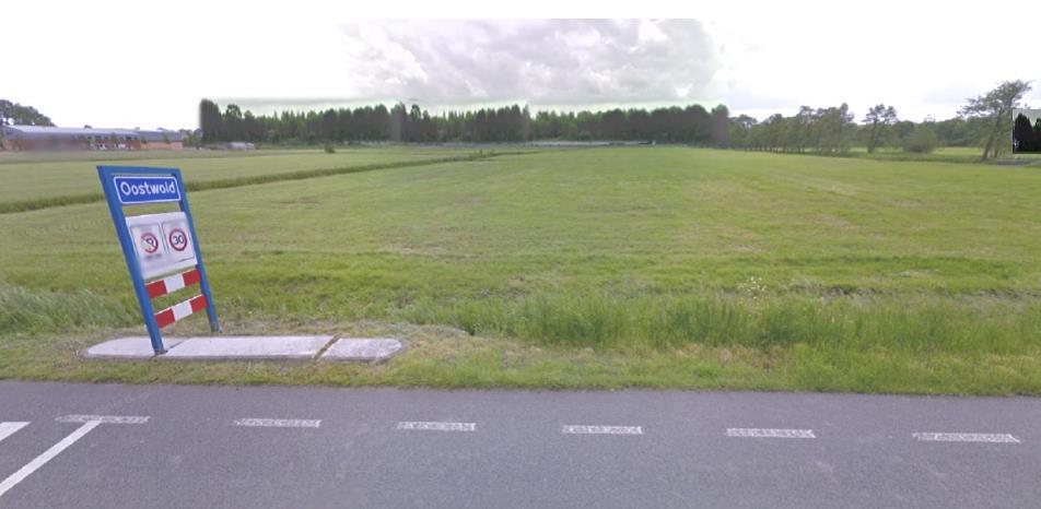 Impressie: zicht vanaf de Hoofdstraat in Oostwold
