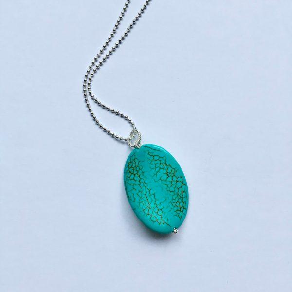 Lange ketting met edelsteen turquoise gedraaide ovaal zilver