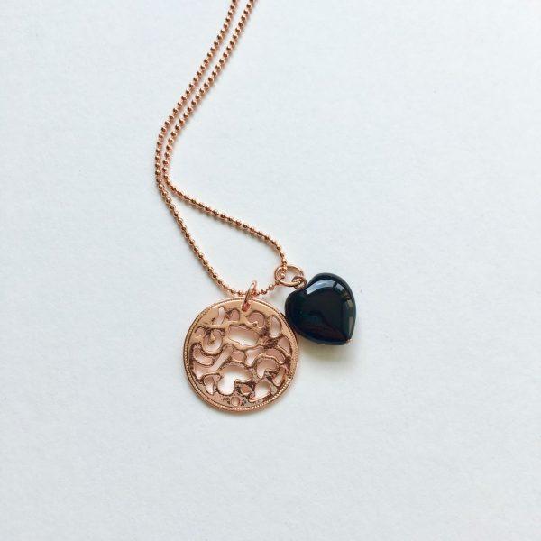 Lange ketting met onyx hart munt bedel rosé goud