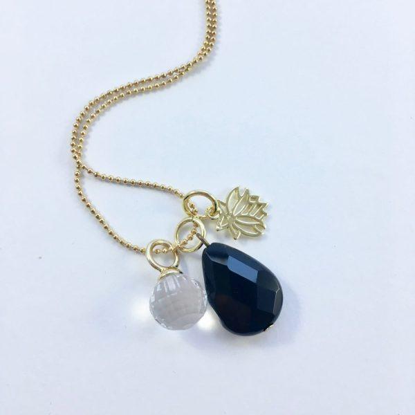 Lange ketting met onyx kwarts lotus goud