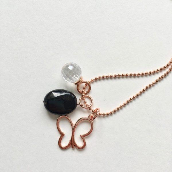 Lange ketting met zwarte glimmende natuursteen zirkonia hanger vlinder bedel rosé goudkleurig