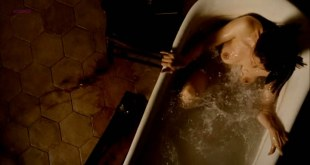Laetitia Casta nude topless in the bath from - Derriere les murs (2011)