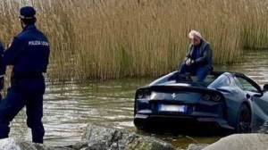 He dived into the lake with the brand new Ferrari!
