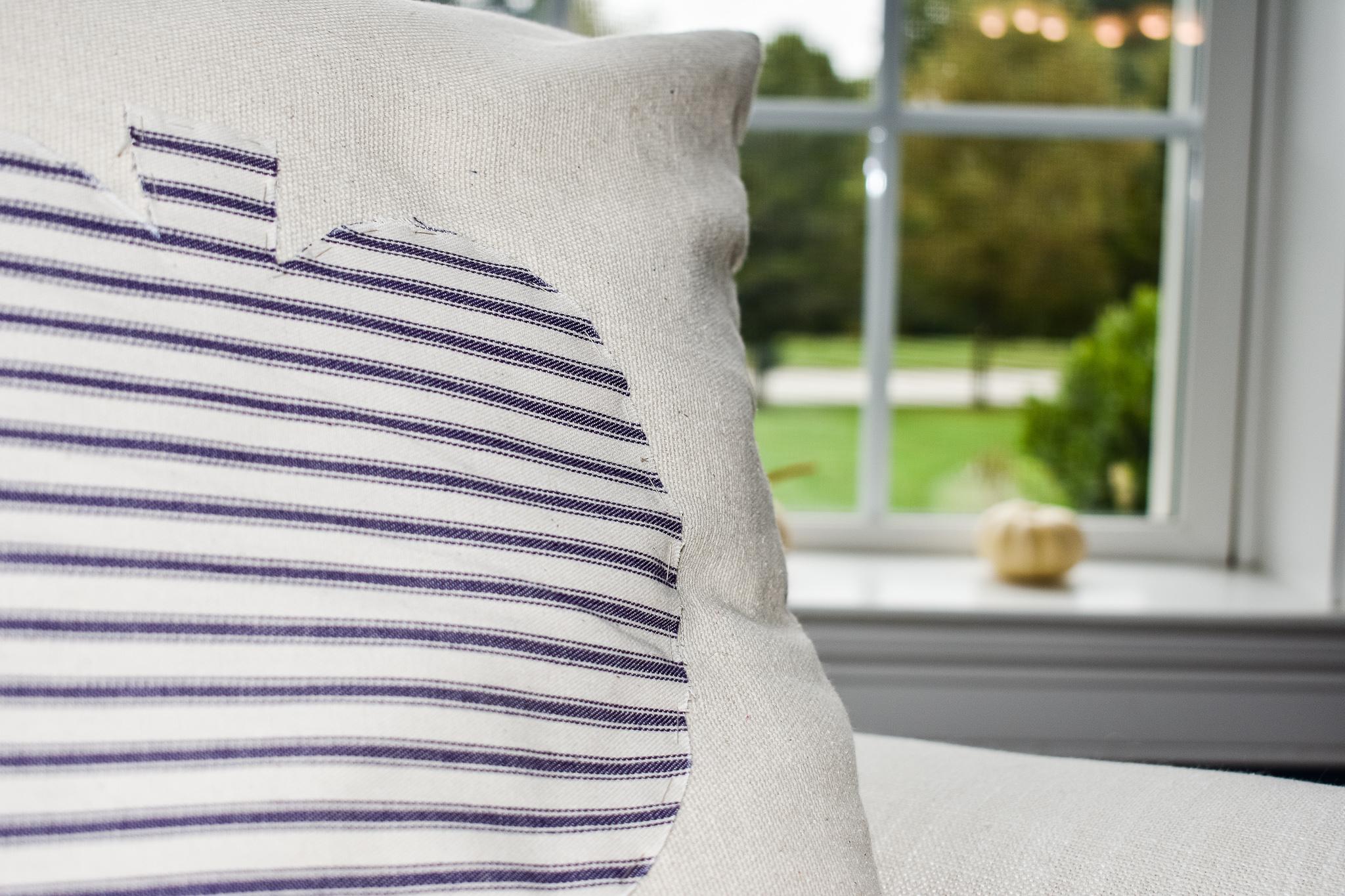 neutral fall pumpkin pillow made of drop cloth and ticking fabric