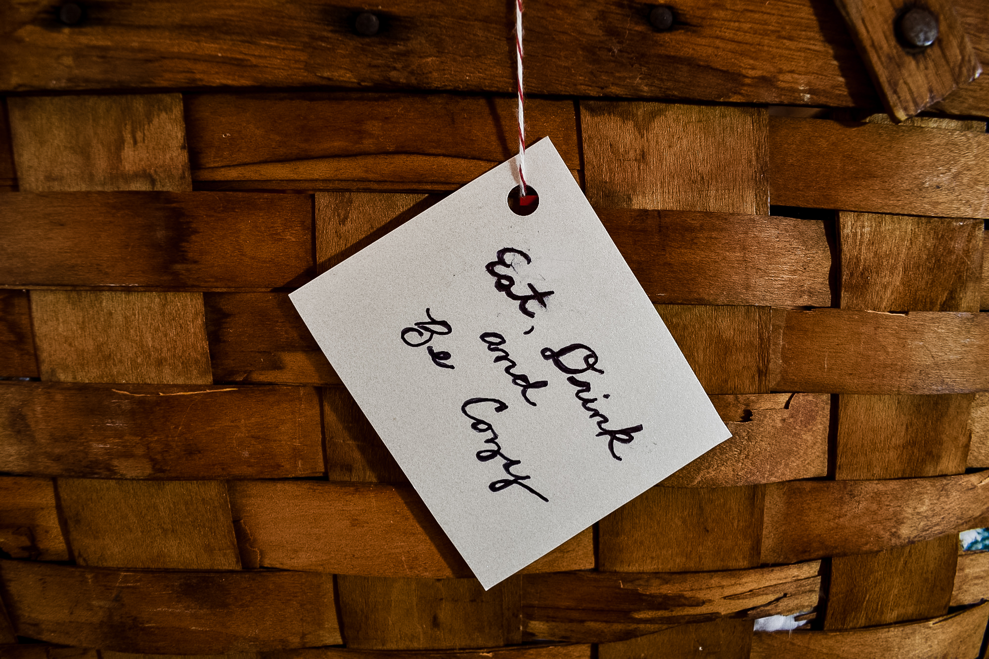 eat, drink and be cozy hand written tag on a hot cocoa gift basket