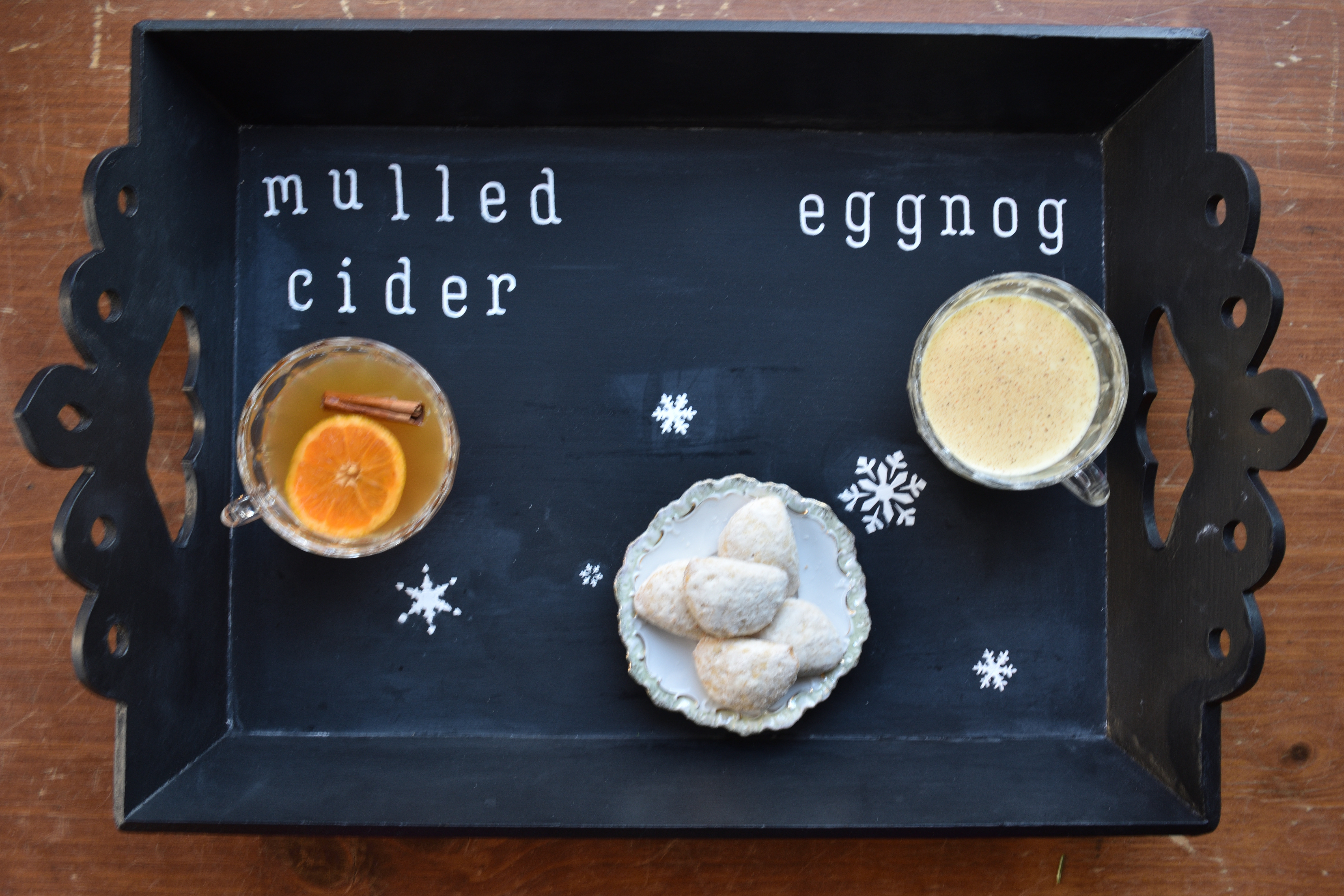 stenciled chalkboard holiday serving tray styled with cookies and beverages