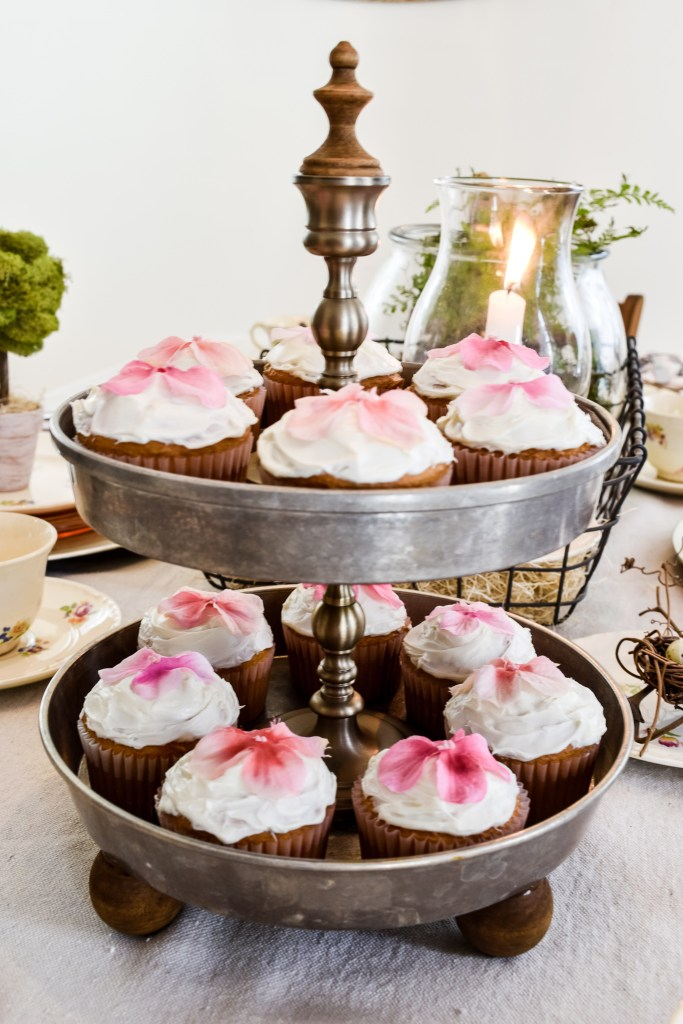 DIY cake pan tiered tray filled with cupcakes on a Spring tablescape