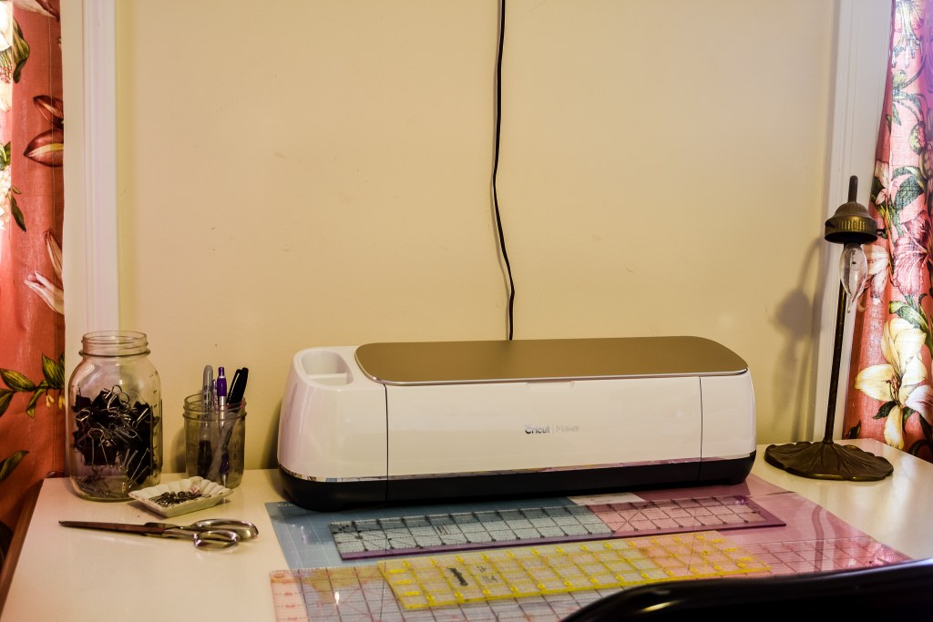 Cricut Maker set up on a table in an organized craft room