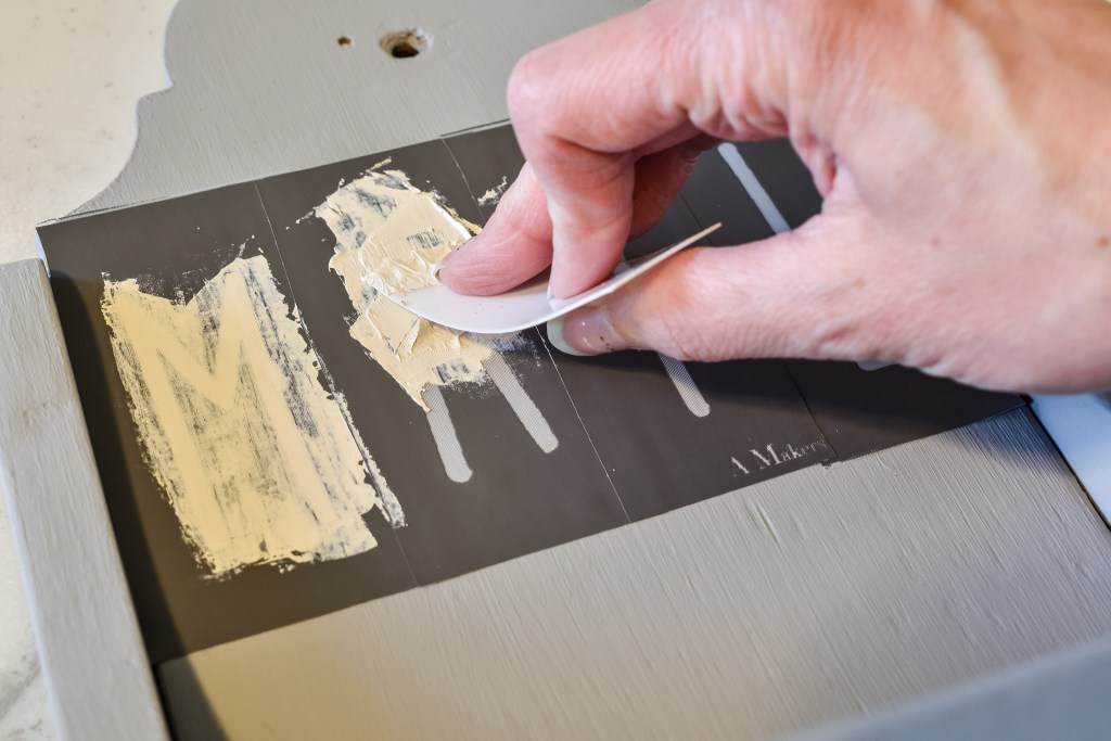 applying paint to stencils