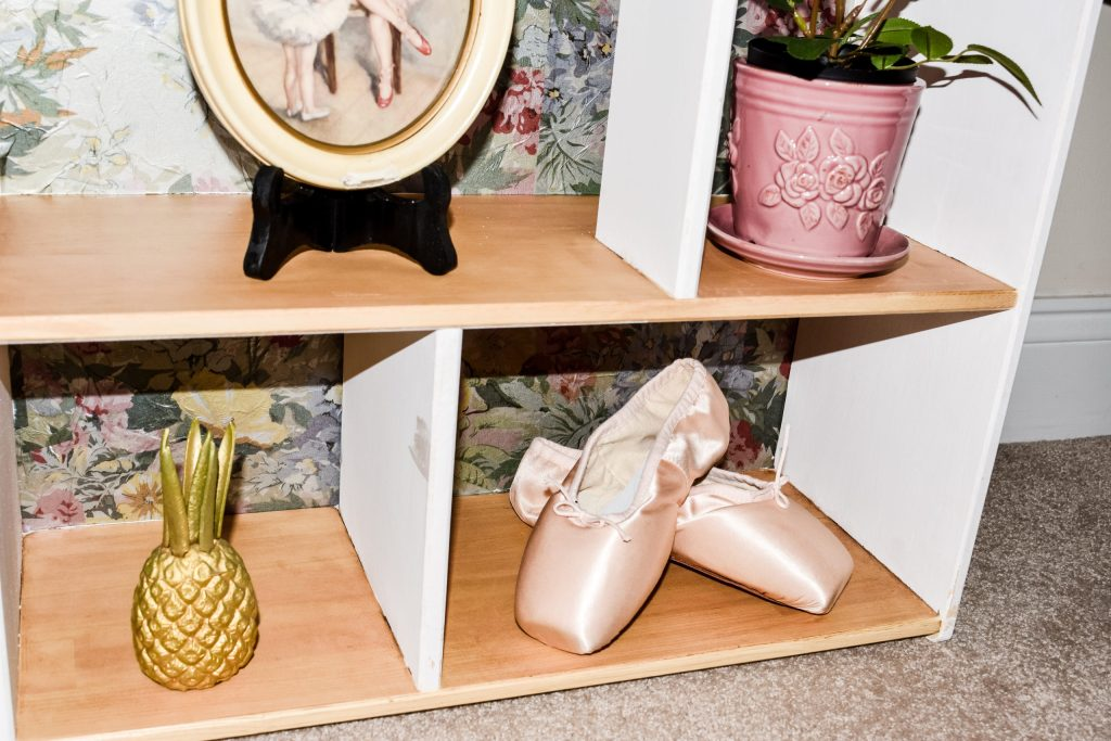 ballet pointe slippers and a gold pineapple