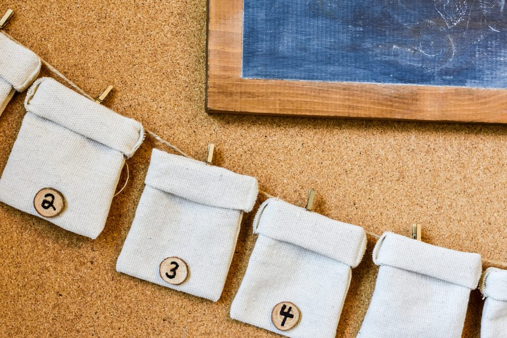 drop cloth bags attached to a jute twine garland advent calendar