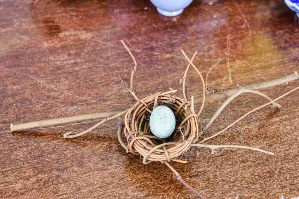 mini twig bird's nest with a blue Easter egg