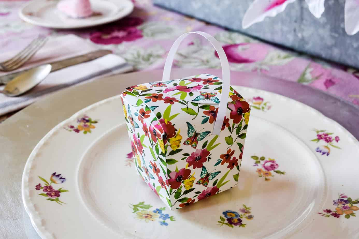 floral cardboard treat box from Dollar Tree on a floral dinner plate