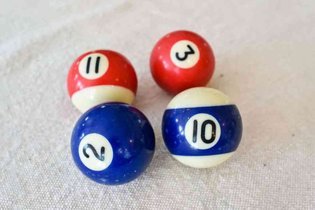 four red white and blue mini pool balls