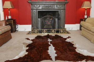 hygge, hygge Christmas, hygge style, cosy rug, cosy open fire, fireplace, rustic style, Nguni cowhide rug, Zulucow cowhide