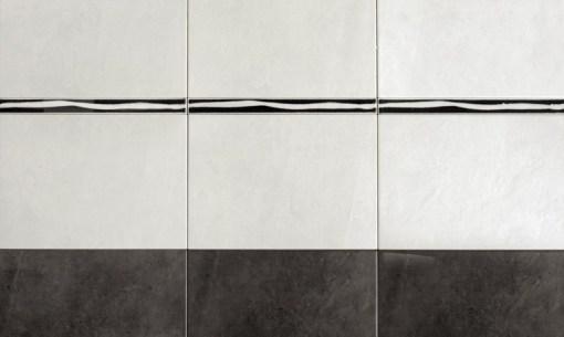 Wandtegel-Herberia-trend-sector-gricio-licht-en-antraciet-33.3x25cm1
