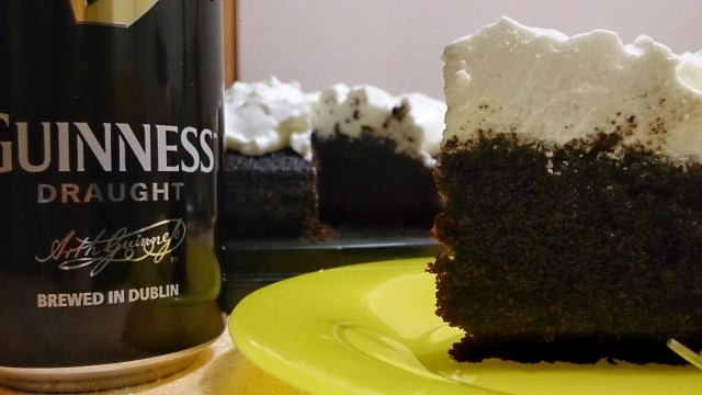 slice of Black Guinness Cake with the side of a beer