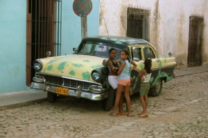 Girls chat in the street, Trinidad, Cuba